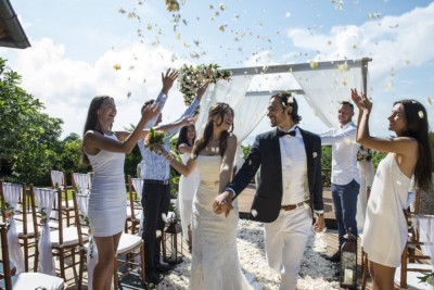 flower shower on a beach wedding in bali
